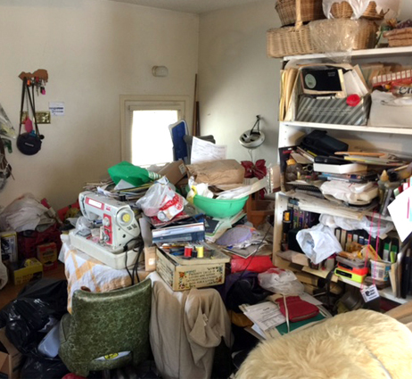 Image Hoarding with image of cluttered room